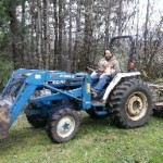 Picture of Tim and Charlie on the tractor together