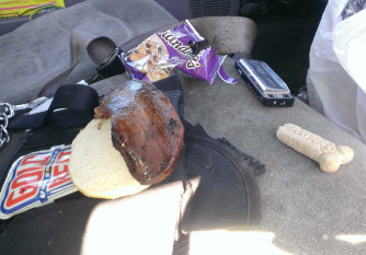 Front seat of the truck with the half of the sandwich Charlie didn't eat laying untouched.
